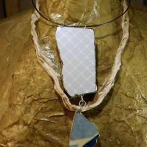 Tile remnant silver solder and steel necklace