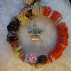 Yarn covered bird ring necklace