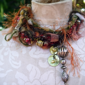 Yarn fringe mixed media charm necklace