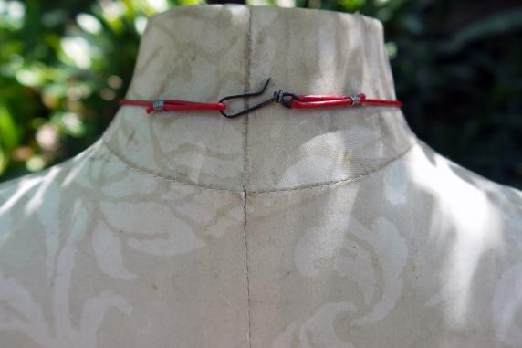Concrete choya disc with dangling enamel charm