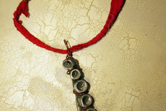 Concrete octopus necklace with recycled red cord