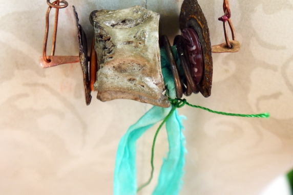 Concrete vertebrae necklace with found objects