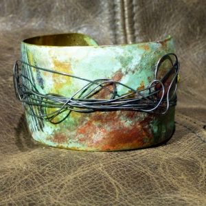 Embossed brass cuff with patina and steel